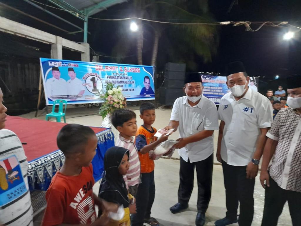 Pasangan Calon Nomor urut satu Walikota dan Wakil Walikota Sibolga, H.Jamaluddin Pohan dan Pantas Maruba Lumbantobing menyerahkan santunan kepada anak yatim piatu dalam rangka memperingati Maulid Nabi Muhammad SAW 1442 Hijriah